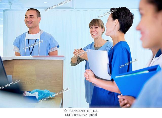 Medical staff chatting at nurses station in hospital