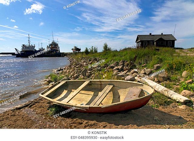 old wooden boat on the seashore, the old ships in the north sea, the fishing village