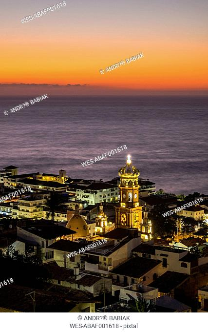 Mexico, Puerto Vallarta, lighted Church of Our Lady of Guadalupe after sunset
