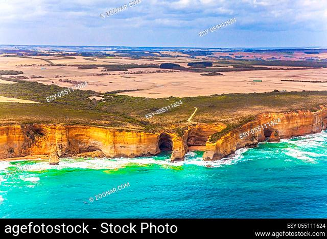 Scenic coastline. Picture taken from a helicopter. Great Ocean Road and the Twelve Apostles - a group of sandstone cliffs on the Pacific coast