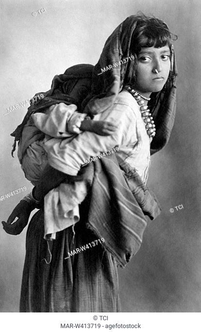 Africa, Ethiopia, Ethiopian girl with her brother, 1930-40