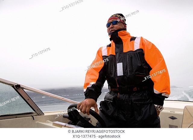 Man sailing his boat, South Greenland