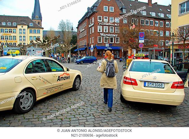 Cabs in the Burgplatz in the Altstadt area. Dusseldorf, North Rhine-Westfalia, Germany, Europe
