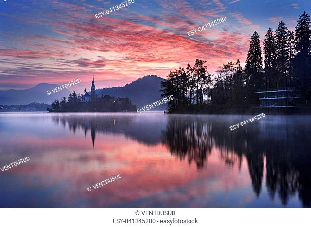 Amazing View for sunrise : Bled Lake, Island, Church And Castle With Mountain Range (Stol, Vrtaca, Begunjscica) In The Background-Bled, Slovenia, Europe