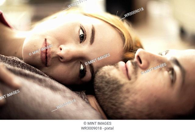 A couple lying together on the floor