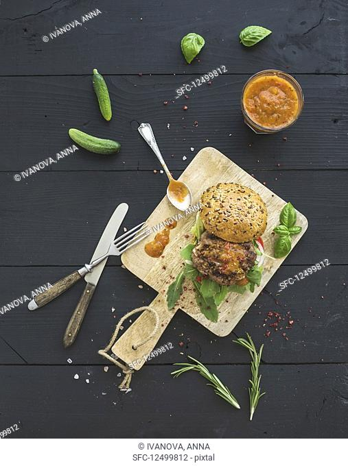 Fresh homemade burger with spicy tomato sauce, sea salt and herbs