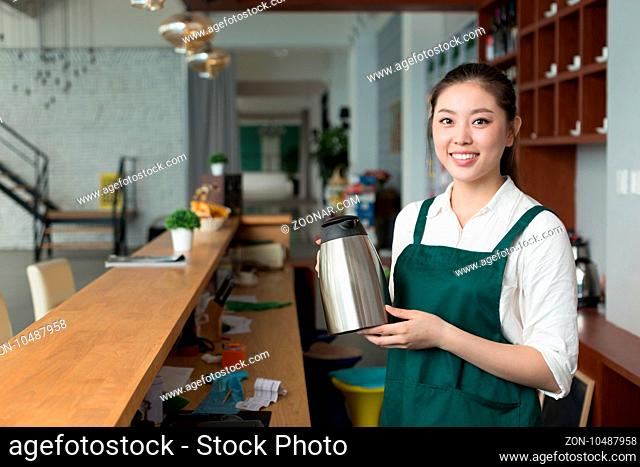 young beautiful woman works near counter in cafe