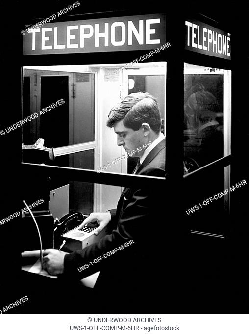 Boston, Massachusetts: c. 1968.This man now has 24 hour access, even from a telephone booth, to a remote computer with the Honeywell Electronic Data Processing...
