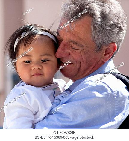 11-month old baby with her adoptive father