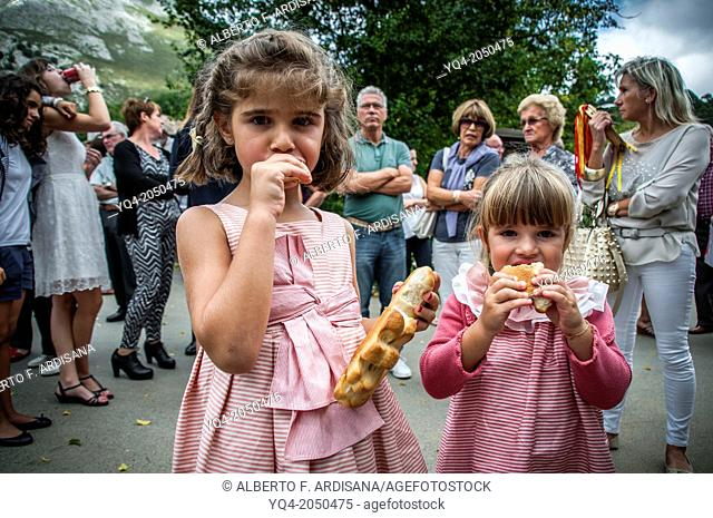 These two young girls will eat traditional holiday breads. Llanes. Asturias. Spain
