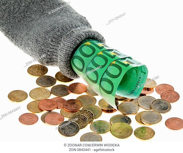Ein Sparstrumpf mit Euro Geld Scheinen und Euros