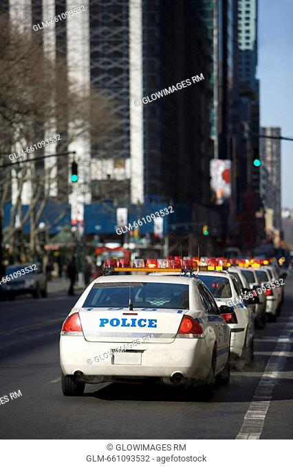 Police cars on a road, Bryant Park, New York City, New York State, USA
