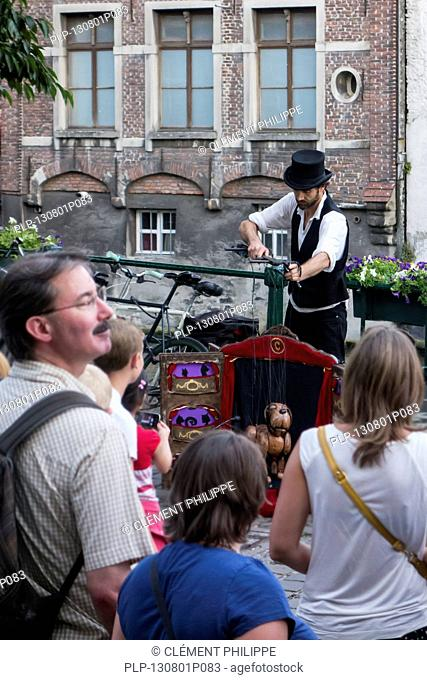 Street animation with marionette during the Gentse Feesten festivities at Ghent, Belgium