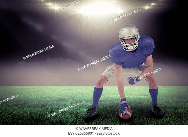 Composite image of american football player in attack stance with 3d