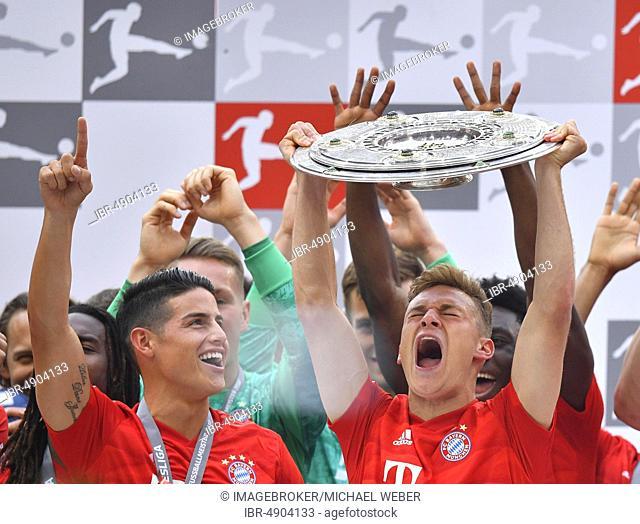 Joshua Kimmich FC Bayern Munich (right) and James Rodriguez FC Bayern Munich (left), cheering with championship bowl, trophy, championship celebration 2019