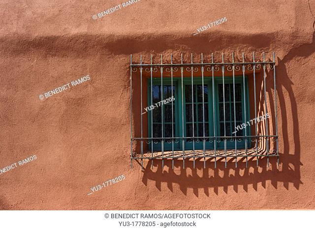 Spanish-style grilled window on adobe house, Santa Fe, New Mexico, USA