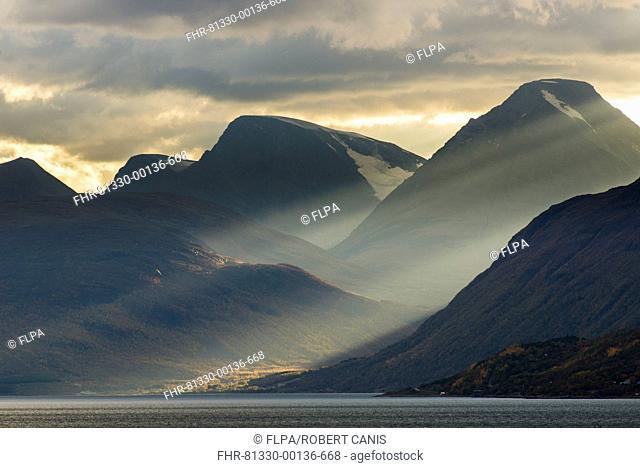 Clouds and sunbeams above fjord, Lyngen Fjord, Skibotn, Lapland, North Norway, September