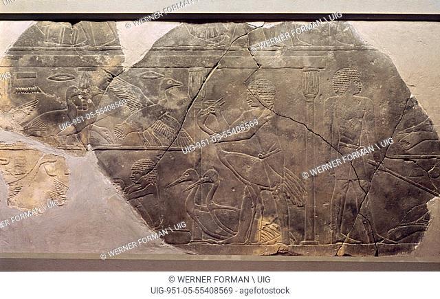 A relief fragment depicting men force feeding cranes