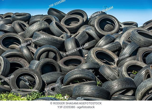 Old vehicle tyres dumped in piles. not biodegradable ..