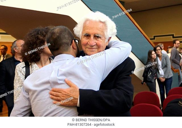 Auschwitz survivor William Glied being hugged by his grandson at the regional court in Detmold, Germany, 17 June 2016. The court sentenced the former...