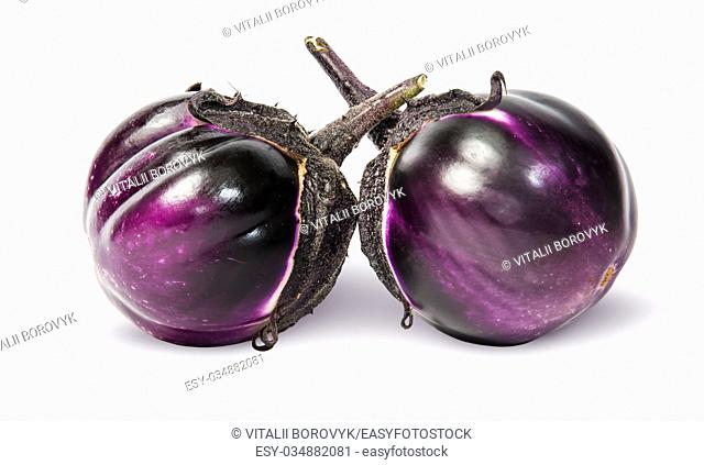 Two round ripe eggplant isolated on white background