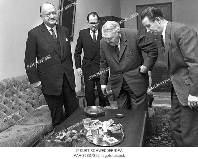Chancellor Ludwig Erhard (M) and the German foreign minister Gerhard Schröder (r) meet the British foreign minister Richard Butler (l) in Bonn on the 10th of...