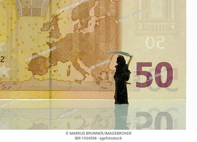 Death is looking at a map of Europe on a 50 euro note, symbolic image for the crisis of the euro