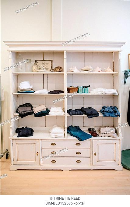 Clothing on shelves in store