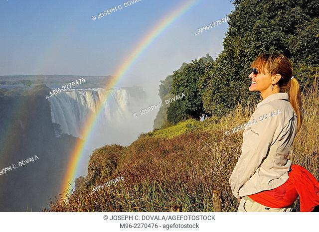 Woman admiring Victoria Falls, Victoria Falls, Zimbabwe, Africa