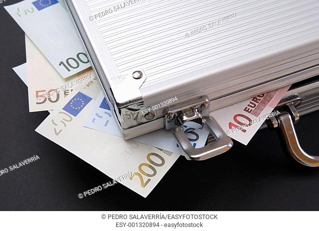 Euro banknotes protruding from a metal briefcase