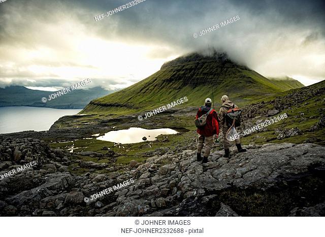 Hikers at mountain lake