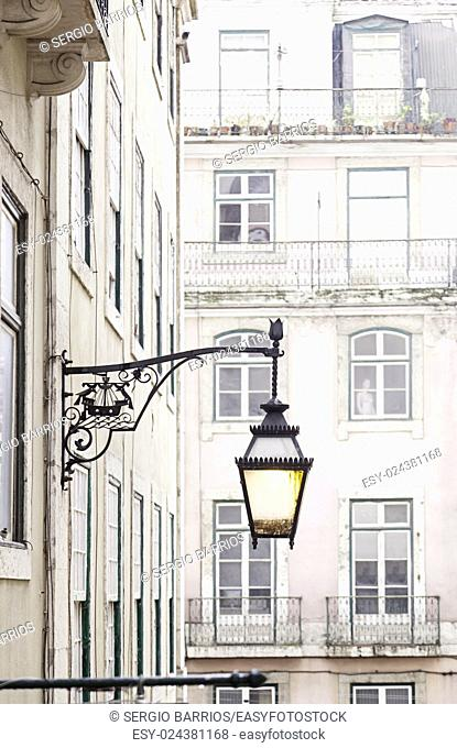 Old street lamp on a classical facade in Lisbon, detail of an old lighting in the city, Art and Tourism