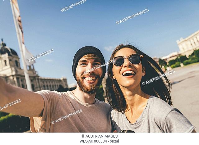 Young couple taking selfie in Vienna