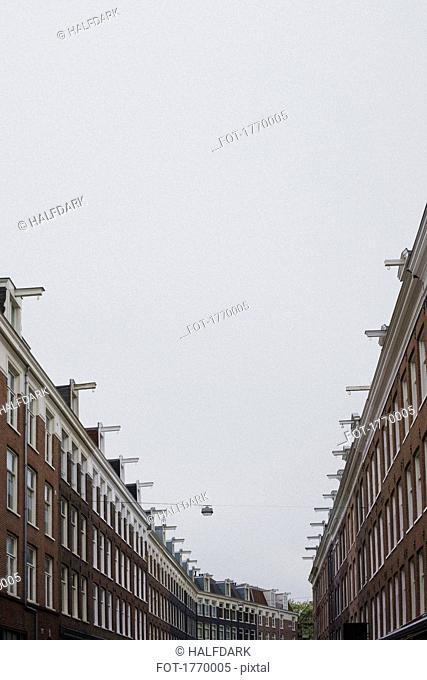 Row houses under overcast sky, Amsterdam, Netherlands, Holland