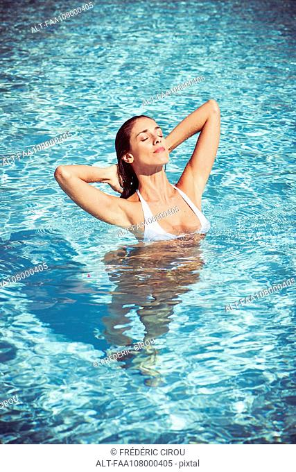 Woman luxuriating in spa swimming pool