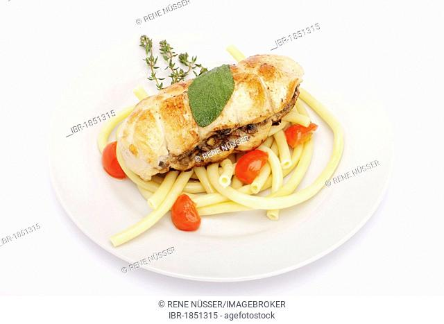 Chicken breast stuffed with chopped mushrooms, on macaroni, sage leaf