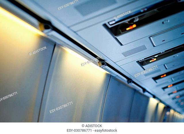 Airplane interior detail. No smoking sign