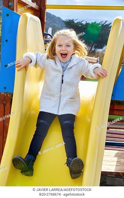 Toboggan, Girl playing in a playground, Zumaia, Gipuzkoa, Basque Country, Spain