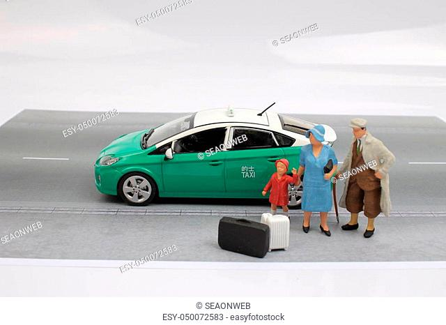 the green taxi of hong kong with figure