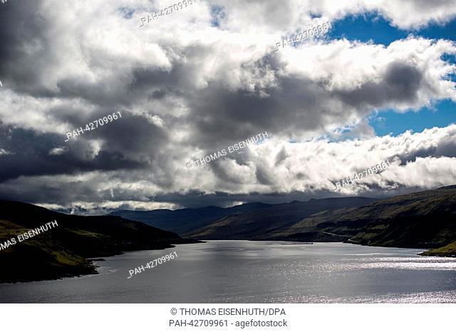 A strait between the islands of Eysturoy (L) and Streymoy, Faroe Islands, 10 September 2013. Around 50, 000 people live on the Faroe Islands