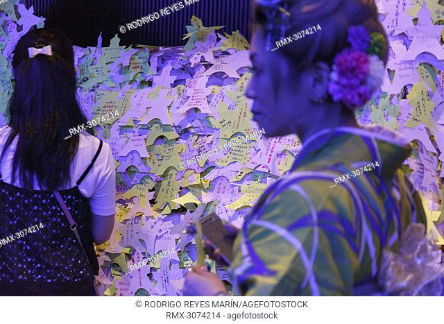 July 7, 2018, Tokyo, Japan - Visitors leave their wishes written on colorful papers during the annual festival of Tanabata in Tokyo Tower