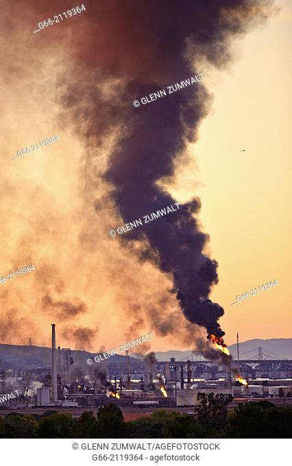 Power outage at refinery causes flairs to burn off excess petroleum production producing thick clouds of toxic black smoke