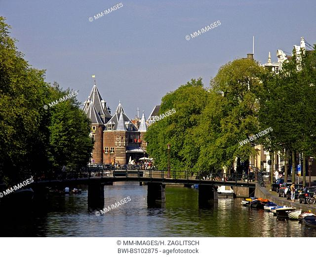 view at canal and the weighing-house in Amsterdam, Netherlands
