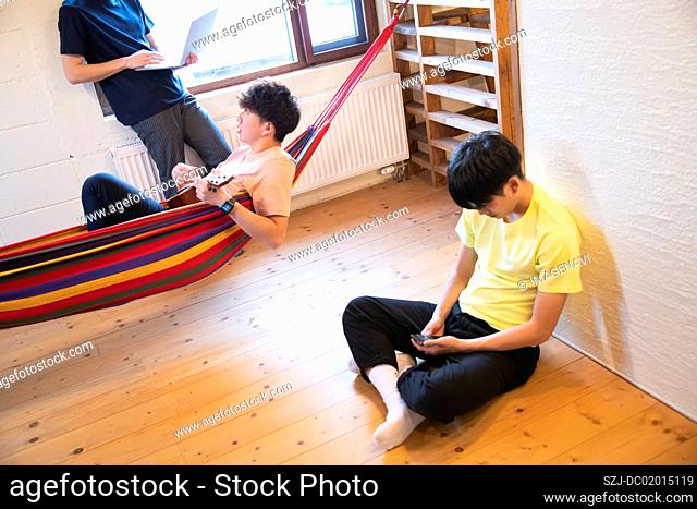 Young people relaxing in vacation rental
