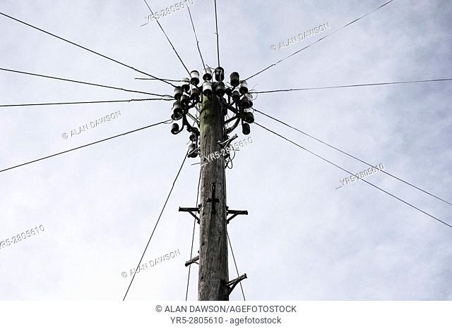 Telegraph pole and telephone lines in street in England. United Kingdom