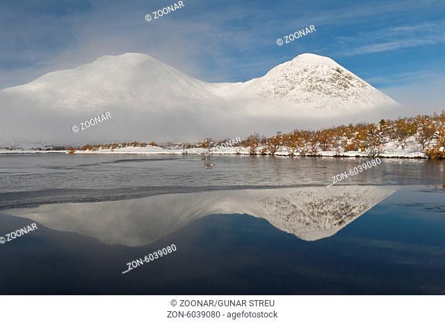 mountains reflecting in a lake, Rondane, Norway
