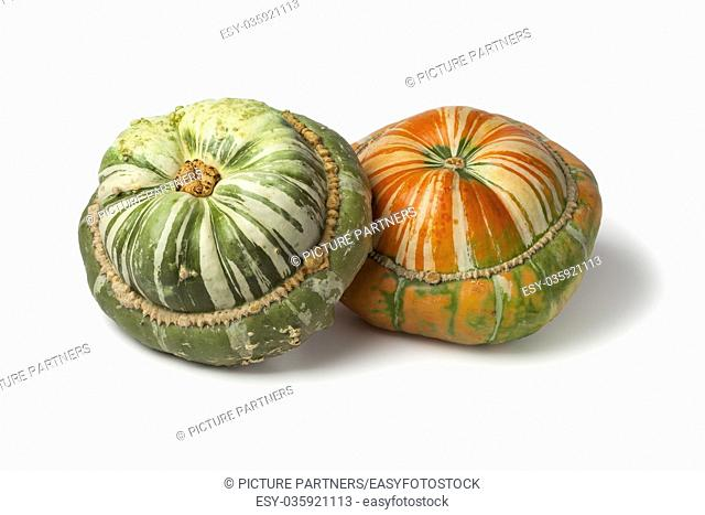 Fresh heirloom orange and green Turban squashes on white background