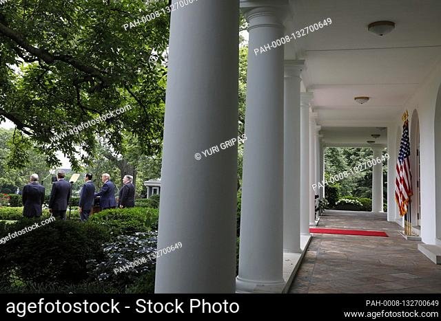 United States President Donald J. Trump with members of his administration delivers remarks on China in the Rose Garden at the White House in Washington