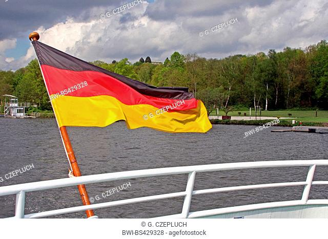 german flag at the stern of an excursion boat, Germany