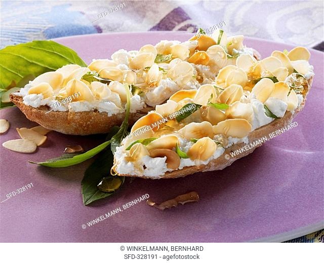 Fresh goat's cheese, honey & almonds on toasted white bread